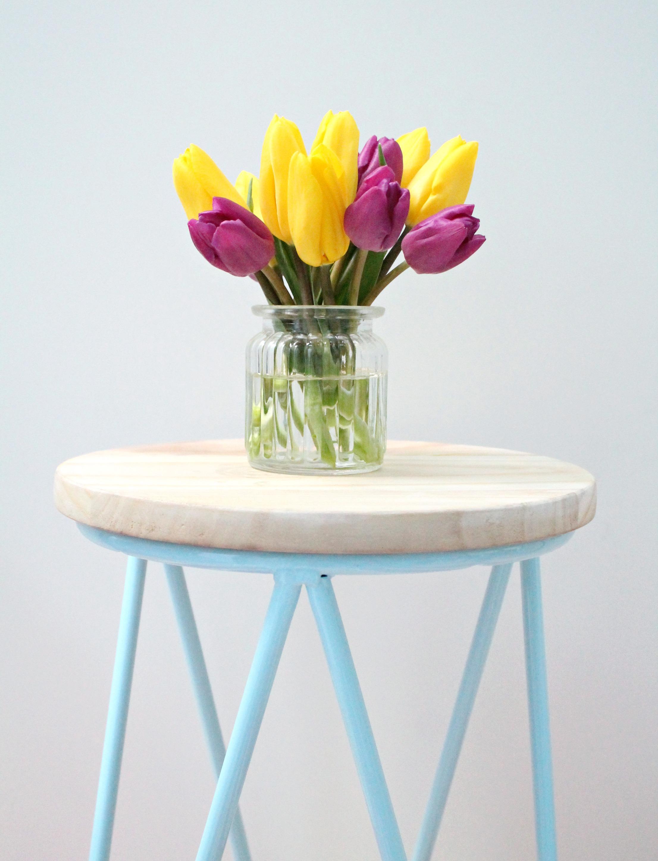 Pretty-tulips-on-blue-stool-photo-by-Geraldine-Tan